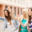 Three beautiful girls waving hands — Stock Photo
