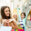 Beautiful woman with shopping bags in the ctiy — Stock Photo #36729019