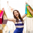 beautiful woman with shopping bags in the ctiy — Stock Photo #36729319