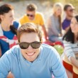 Smiling man in sunglasses on the beach — Stock Photo