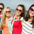 Beautiful teenage girls having fun on the beach — Stock Photo #36729509