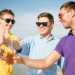 Stockfoto: Group of male friends having fun on the beach