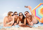 Group of people taking picture with smartphone — Stock Photo