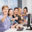 Students with computer monitor showing thumbs up — Foto Stock