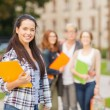 Smiling female student with folders — Stock Photo #36730531
