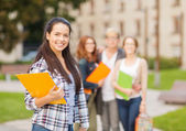 Smiling female student with folders — Stock Photo