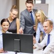 Business team with monitor having discussion — Stock Photo #36777997