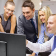 Business team with monitor having discussion — Stock Photo