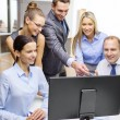 Business team with monitor having discussion — Stock Photo #36778049