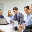 Stock Photo: Business team with laptop having discussion