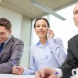 Business team with smartphones having conversation — Stock Photo