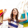 beautiful woman with shopping bags in the ctiy — Stock Photo #36779253