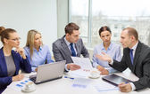 Business team with laptop having discussion — Stock Photo