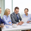 Business team with tablet pc having discussion — Stock Photo #36850279