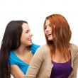 Two laughing girls looking at each other — Stock Photo #37004351