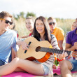 Group of friends having fun on the beach — Foto de Stock