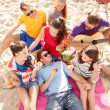 Group of friends having fun on the beach — Stock Photo #37005587