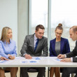 Business team with documents having discussion — Stock Photo