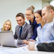 Business team with laptop having discussion — Stock Photo #37005929