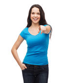 Happy girl in blank blue t-shirt pointing at you — Stock fotografie