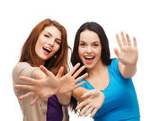 Two smiling girls showing their palms — Stock Photo