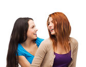 Two laughing girls looking at each other — ストック写真