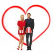 Smiling man and woman with gift boxes — Stock Photo