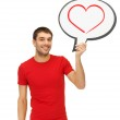Smiling man with text bubble and heart in it — Stock Photo