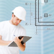 Male architect looking at blueprint — Stock Photo #37059339