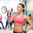 Smiling fit woman with megaphone — Stock Photo