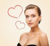 Charming woman wearing shiny diamond earrings — Stock Photo
