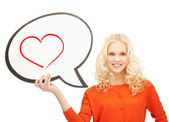 Smiling student with text bubble and heart in it — Foto Stock