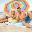 Stock Photo: Smiling couple sunbathing on the beach