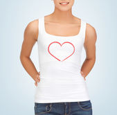 Woman in white tank top with heart on it — Stock Photo