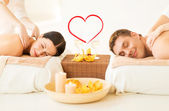 Couple getting massage in spa salon — Stock Photo
