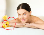 Smiling woman in spa salon — Stock Photo
