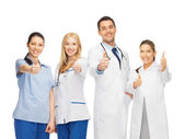 Group of doctors showing thumbs up — Stock Photo