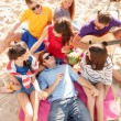 Group of friends having fun on the beach — Stock Photo #37136927