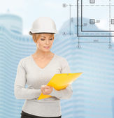 Female contractor in white helmet with files — Stock Photo