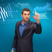 Businessman working with imaginary virtual screen — Stock Photo