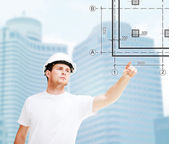 Male architect pointing at blueprint — Stock Photo