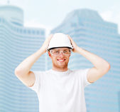 Male architect in helmet with safety glasses — Stock Photo