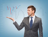 Buisnessman showing forex chart — Stock Photo