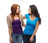 Two smiling girls looking at each other — Foto Stock