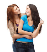 Two laughing girls looking at each other — Stockfoto