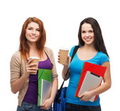 Two students with bag, folders, tablet and coffee — Stock Photo