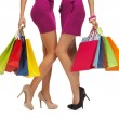 Two women in pink dresses with shopping bags — Stock Photo #37185437
