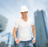 Handsome builder in white helmet — Stock Photo