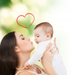 Happy mother kissing her child — Stock Photo #37245089