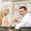 Smiling couple drinking wine in cafe — Stock Photo